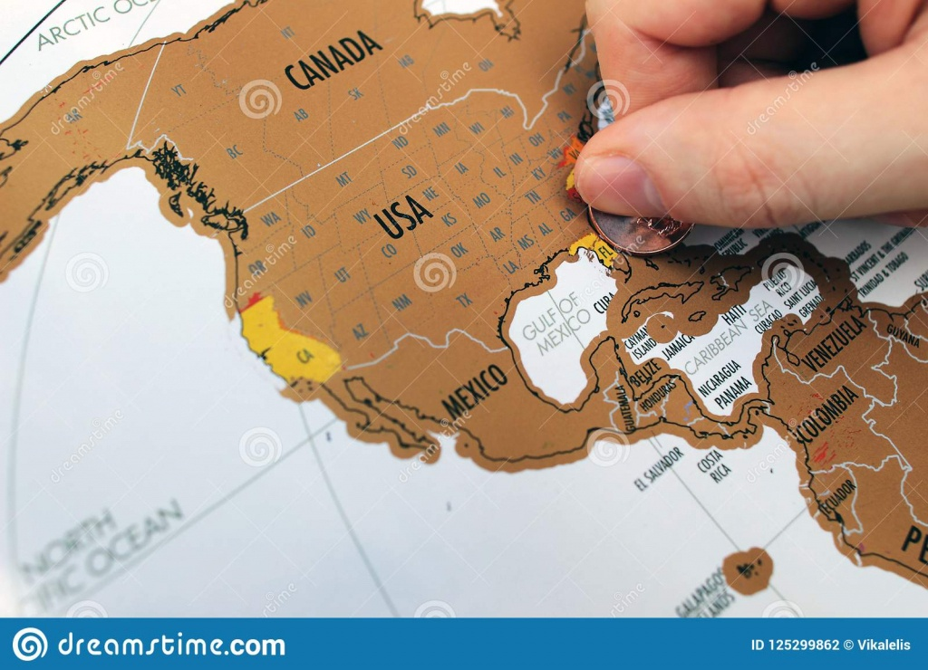 Man`s Hand Scratching Off Visited Places On A Map. Stock Photo - Florida Scratch Off Map